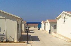 Karmod Líbiá tömeges lakhatási projektet végzett